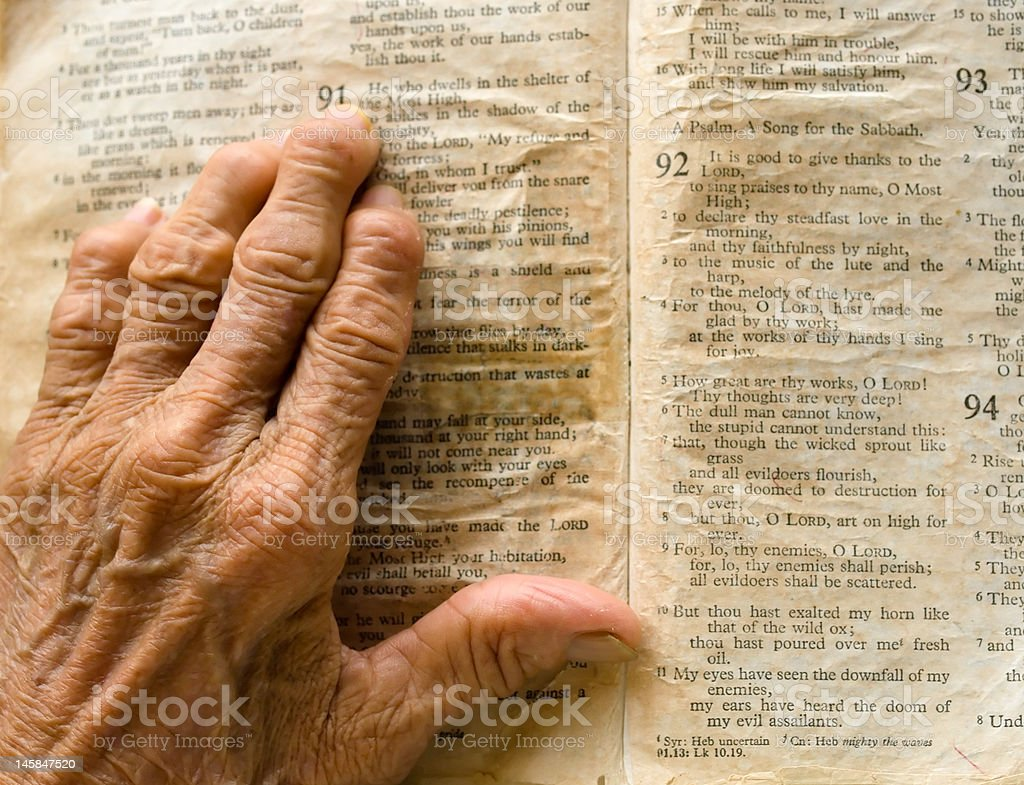 Hand on Bible royalty-free stock photo