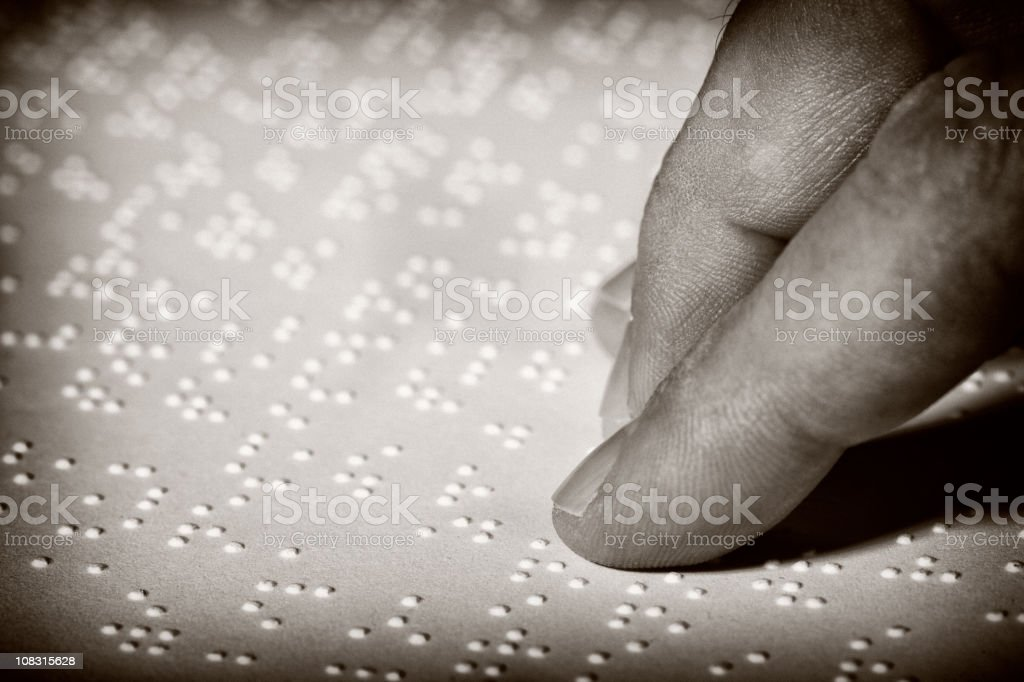 Hand on Braille​​​ foto