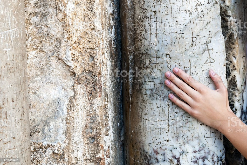 Hand on crosses carved into stone pillar at Holy Sepulchre stock photo