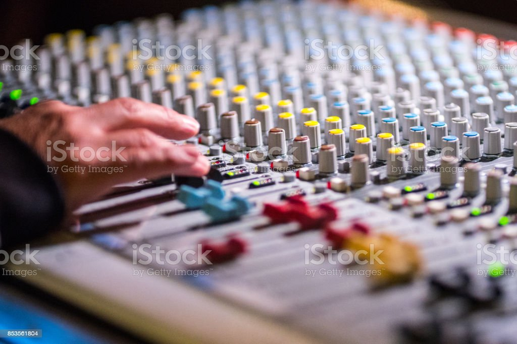 Hand on digital mixing console stock photo