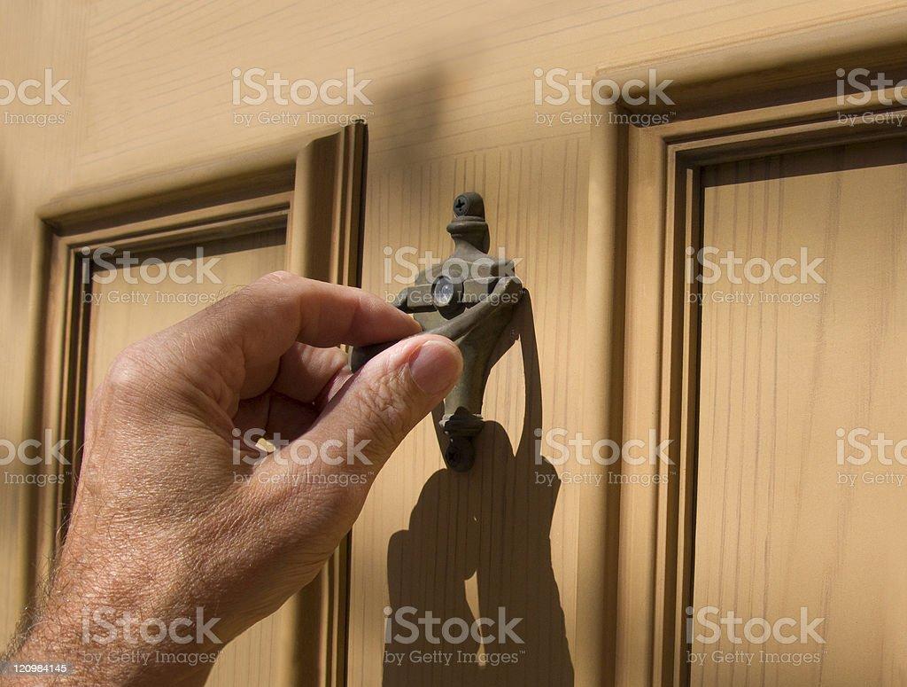 hand on door knocker stock photo