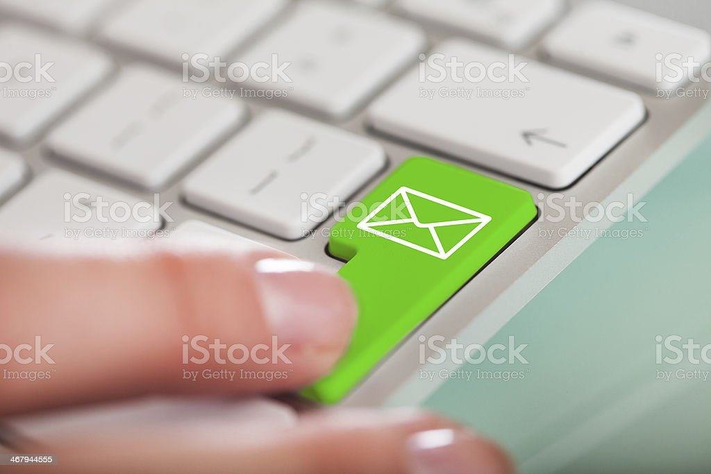 Hand On E-mail Key stock photo