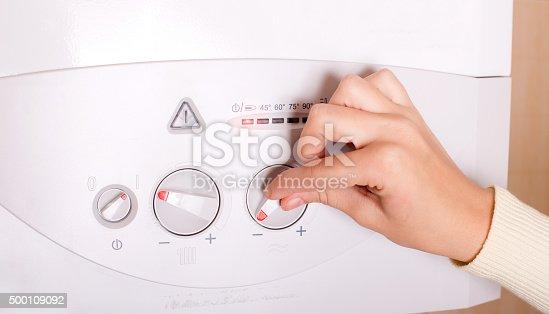 istock Hand on gas boiler 500109092