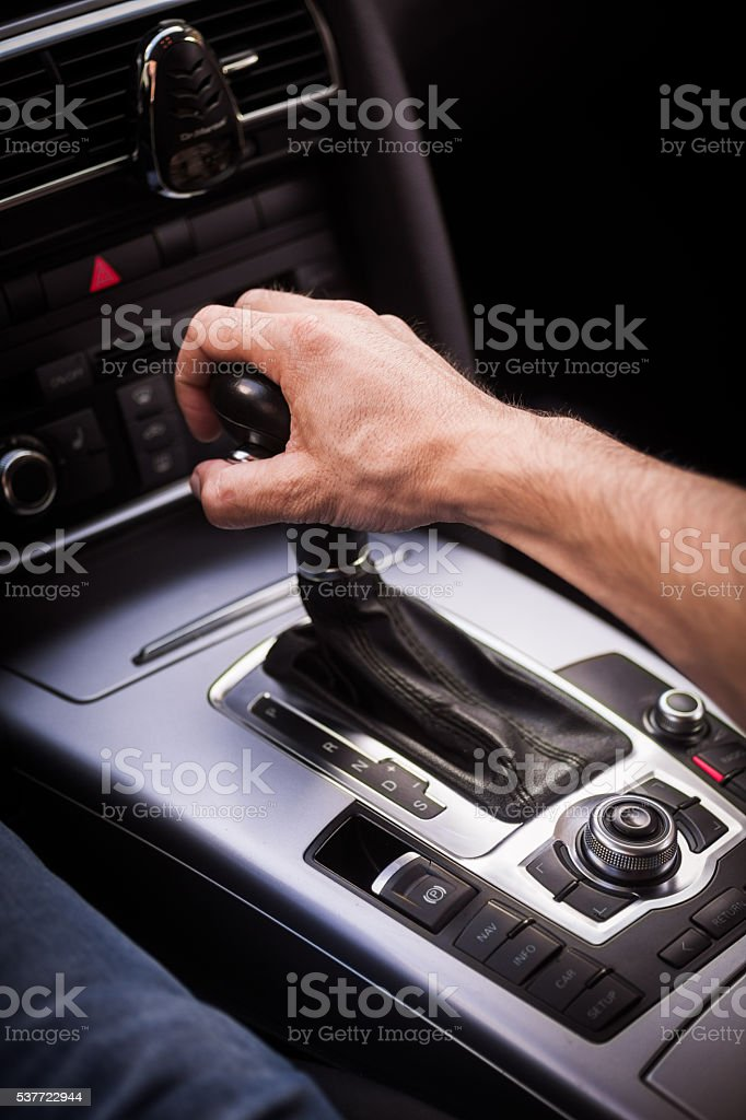 Hand on gear stick stock photo
