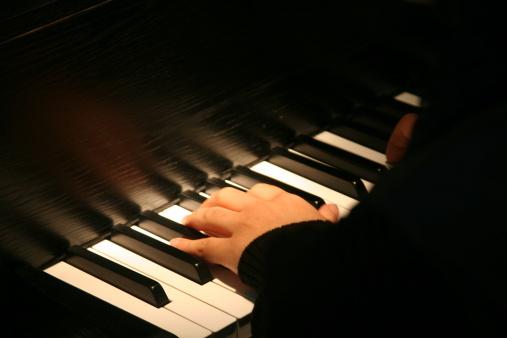 Hand on grand piano