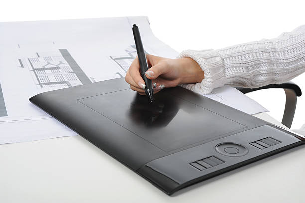 hand on graphic tablet. stock photo