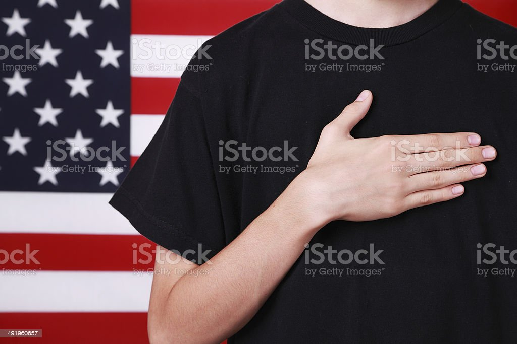 Hand on Heart by American Flag stock photo