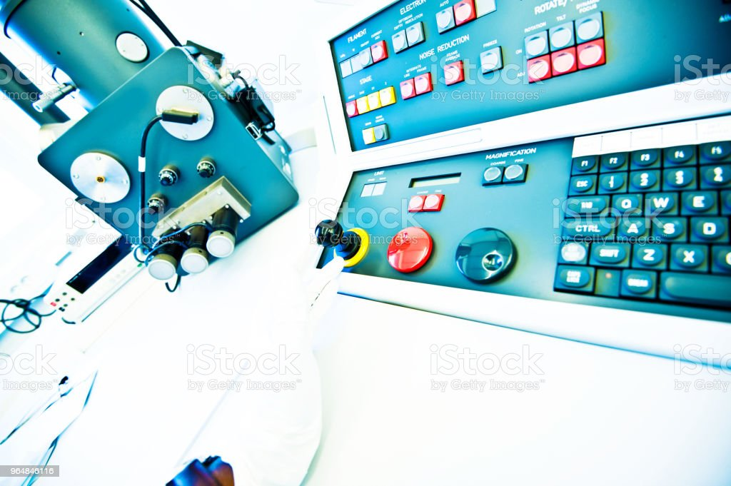 Hand On High Resolution Console In Master Control Room - Measurement and Instrumentation Device royalty-free stock photo