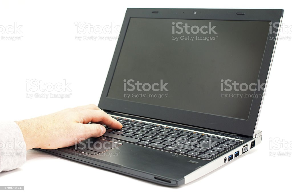 Hand on Laptop royalty-free stock photo