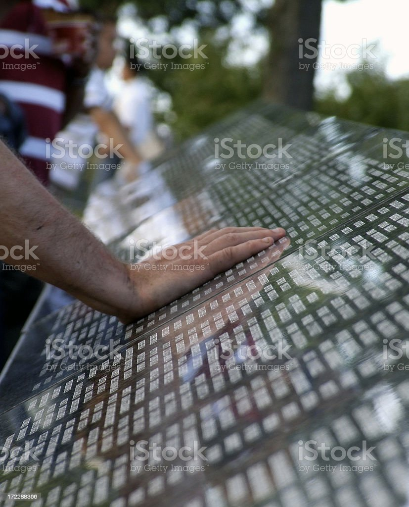 Hand on Memorial Wall royalty-free stock photo