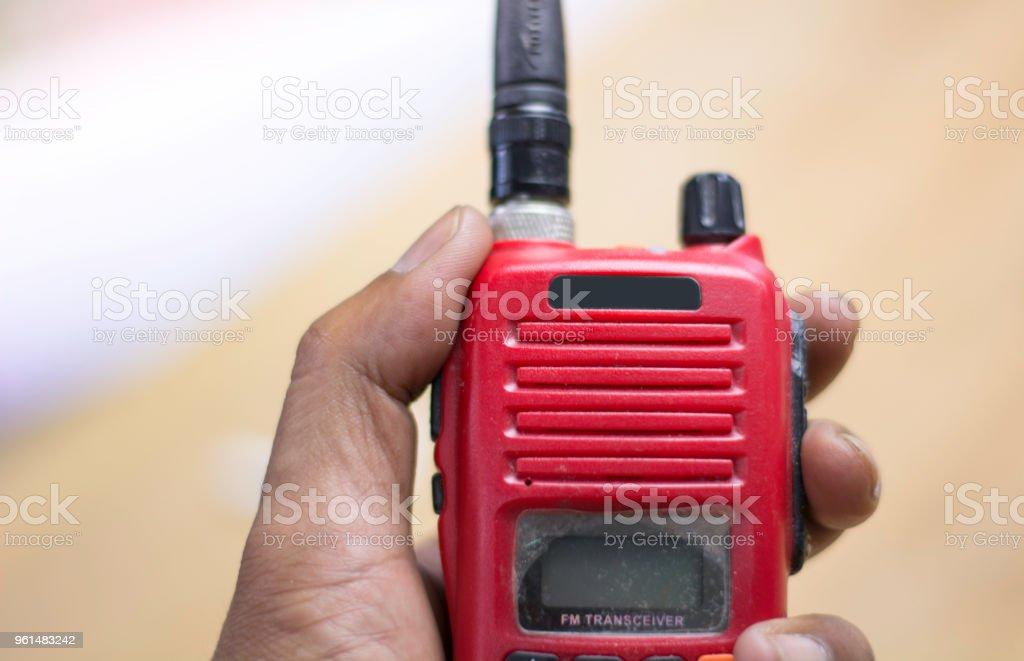 hand on radio communication, two way radio, walkie-talkie. stock photo