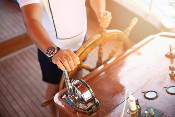 Hand on ship rudder stock photo