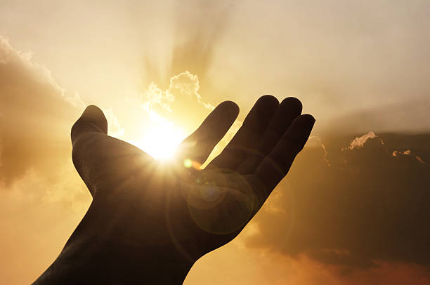 hand on sunset background - praise and worship stock photos and pictures