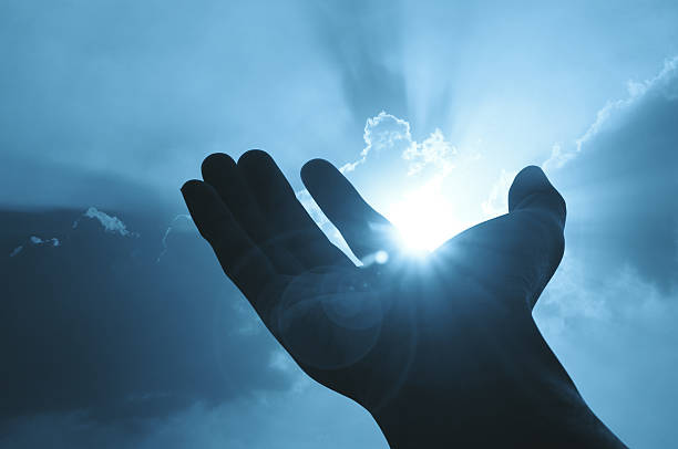 hand on sunset background success, peace,freedom concept - god stock photos and pictures