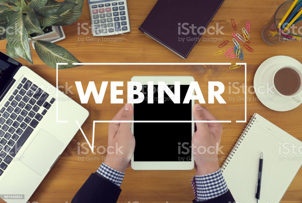 WEBINAR hand on table use E-business Browsing Connection in computer, coffee, Split tone stock photo