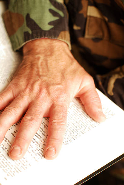 hand on the bible stock photo