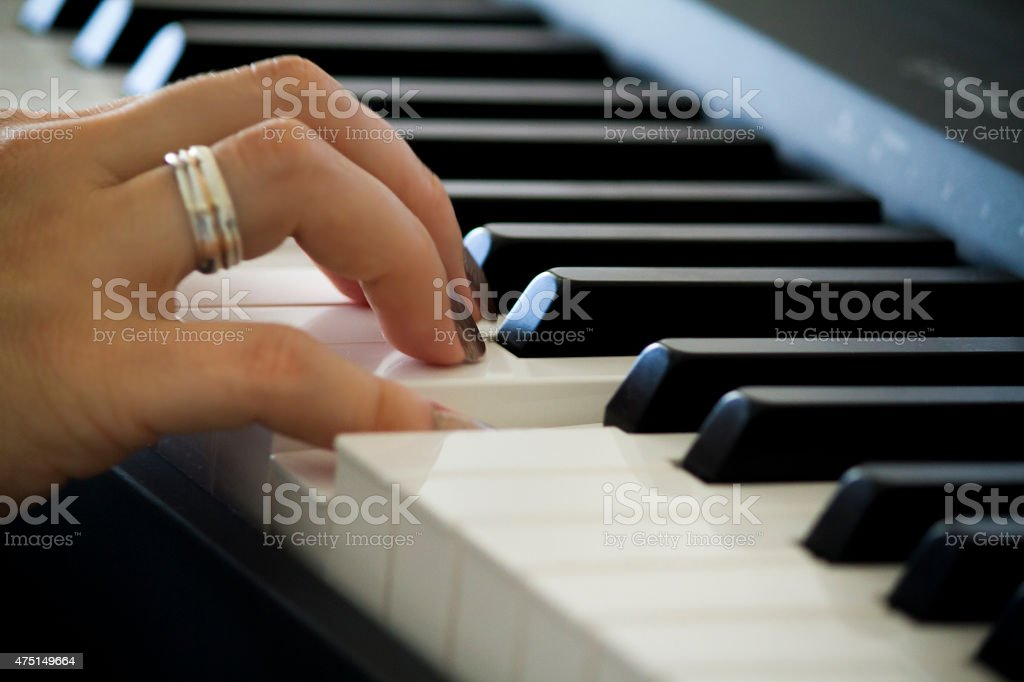 Hand on the Piano stock photo