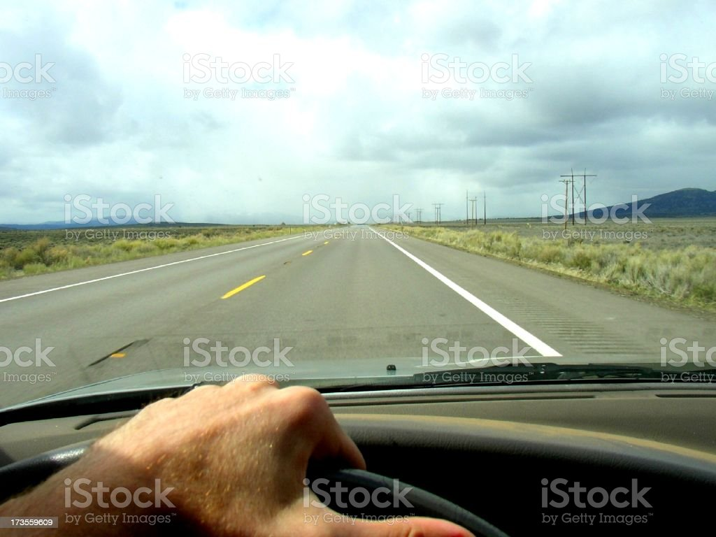 Hand on the wheel royalty-free stock photo