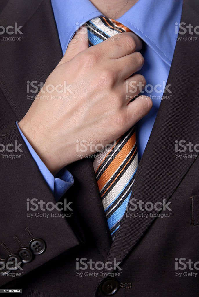 hand on tie royalty-free stock photo