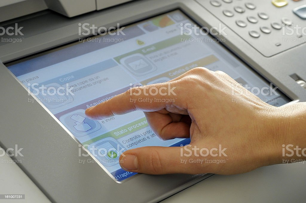 hand on touchscreen stock photo
