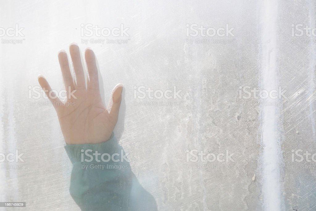 Hand on window royalty-free stock photo