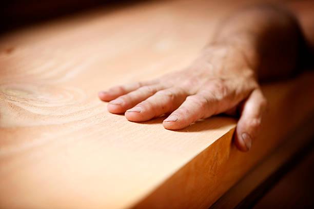 Hand on wood – Foto