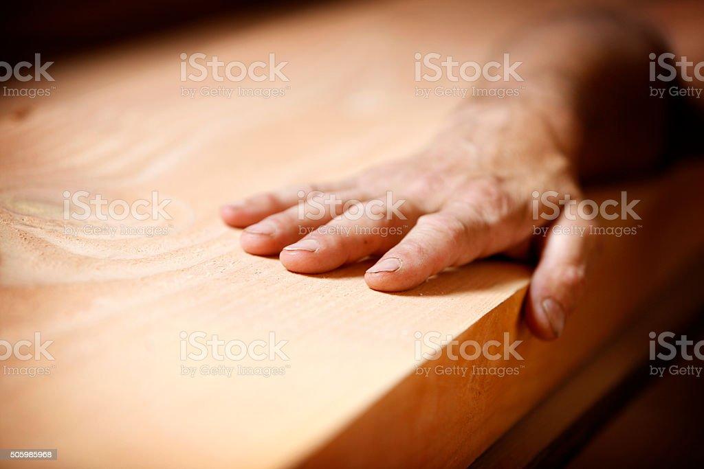 Hand on wood - Lizenzfrei Anstrengung Stock-Foto