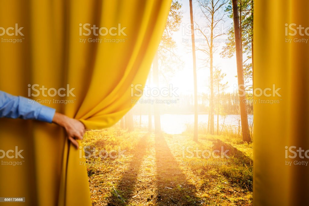 hand open curtain - concept of change and reveal new better world stock photo