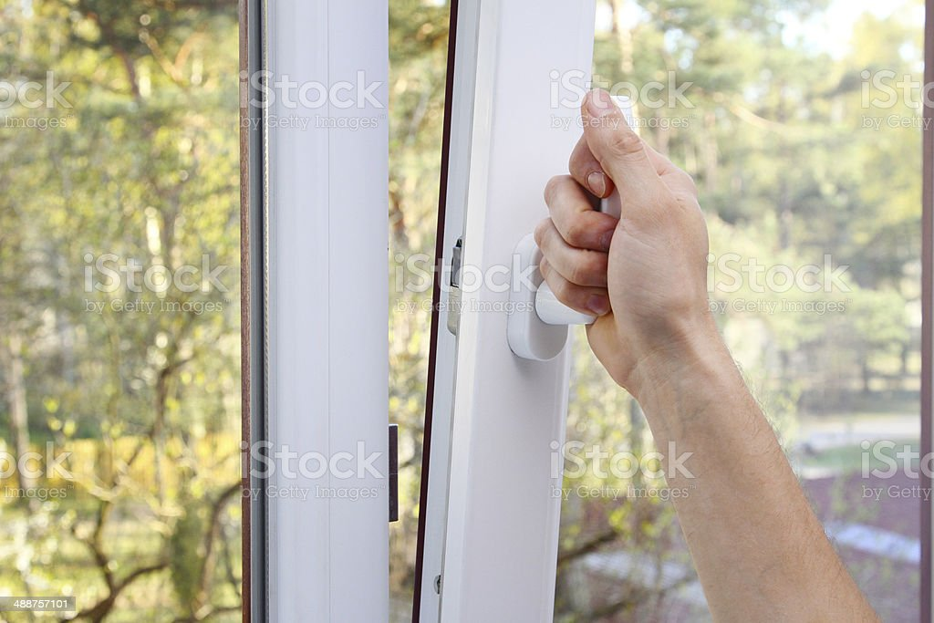 hand open plastic window stock photo