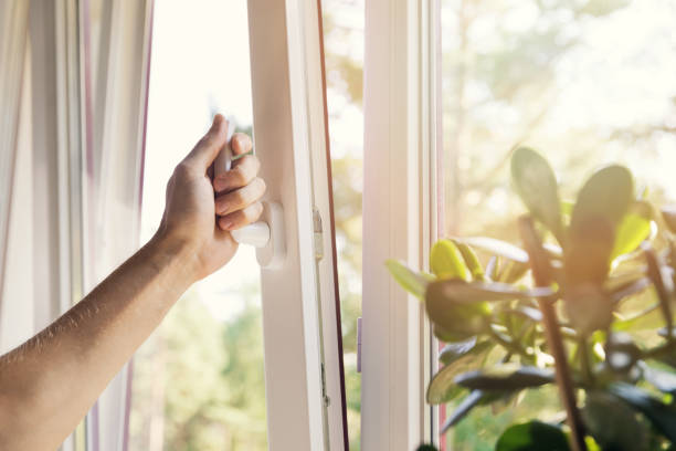 hand open white plastic pvc window at home stock photo