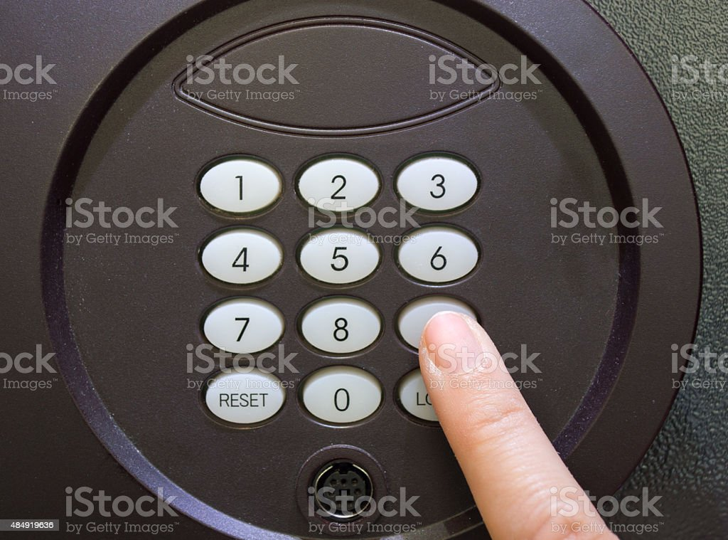 hand opening a safe stock photo