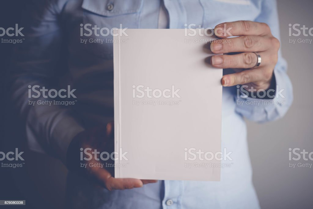 Hand opening blank white booklet mockup stock photo