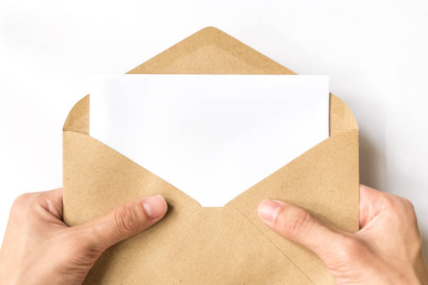 hand opening brown document envelope with copy space - mail stock photos and pictures