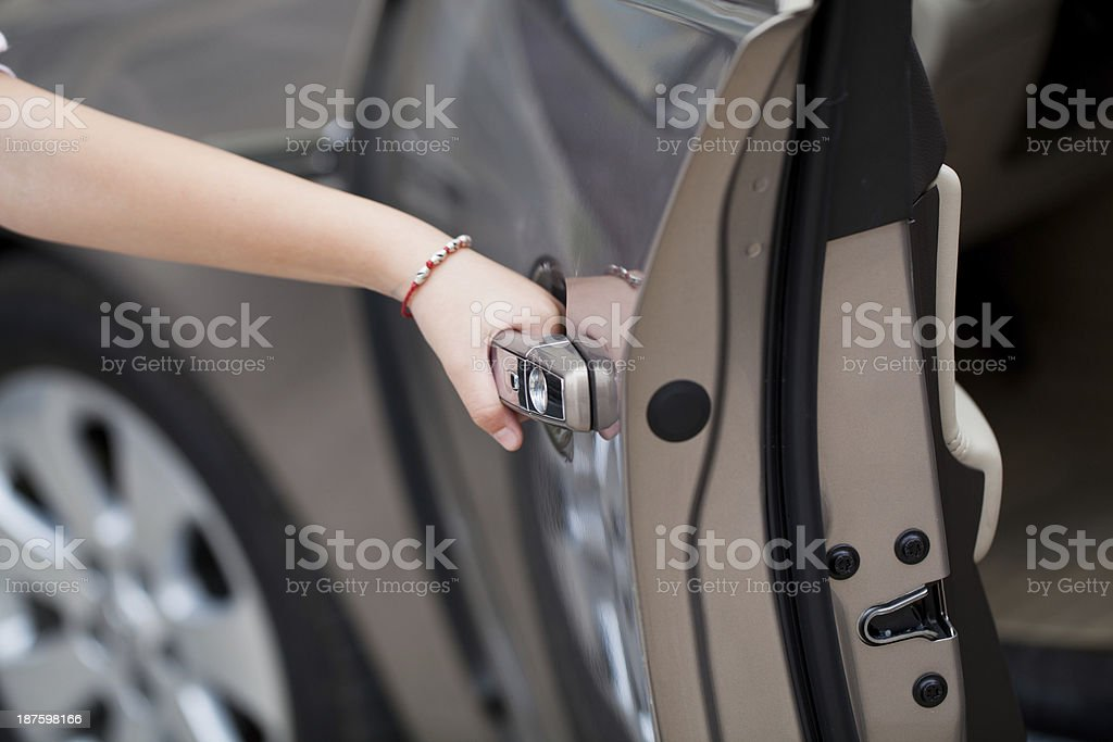 Hand opening car door stock photo