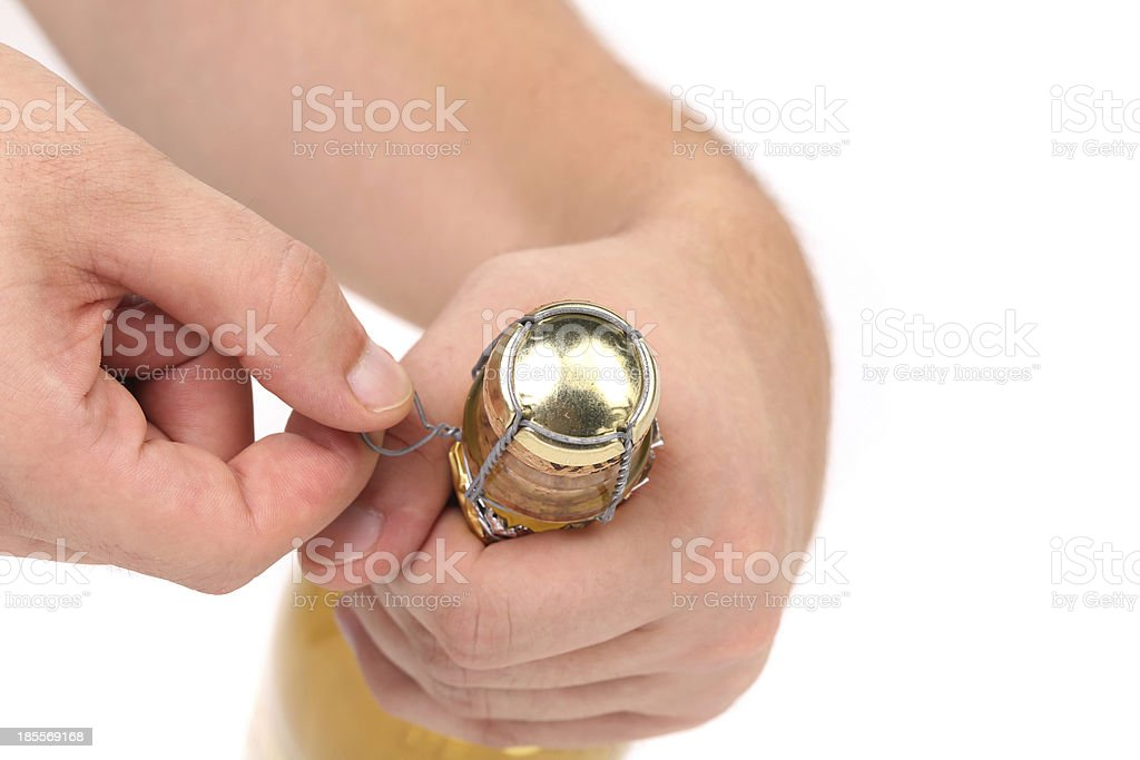 Hand opening champagne bottle royalty-free stock photo