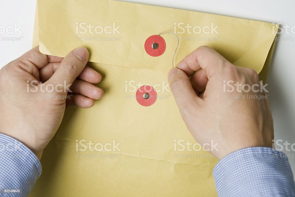 Hand opening confidential envelope stock photo