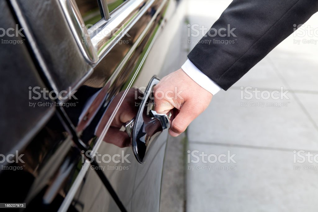 Hand Opening Limosine Door royalty-free stock photo