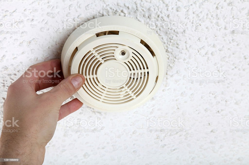 Hand Opening Smoke Detector for Maintenance royalty-free stock photo