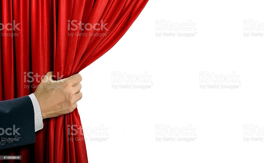 Hand opening stage red curtain over white stock photo