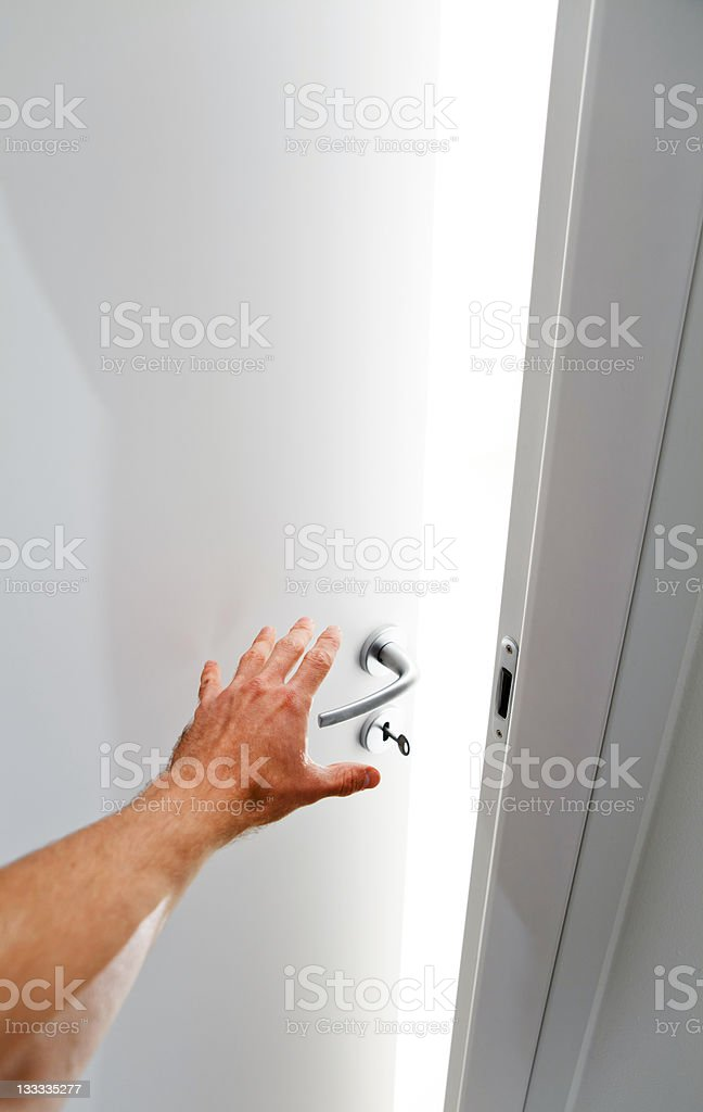 Hand opening the door royalty-free stock photo