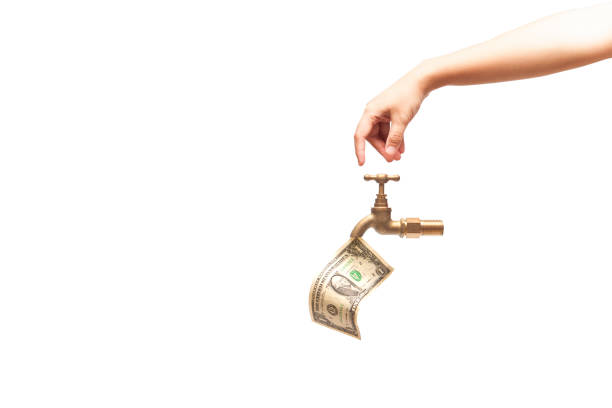 Hand opening the water tap, money falling from the water tap isolated on white background, financial concept. Hand opening the water tap, money falling from the water tap isolated on white background, financial concept. water wastage stock pictures, royalty-free photos & images