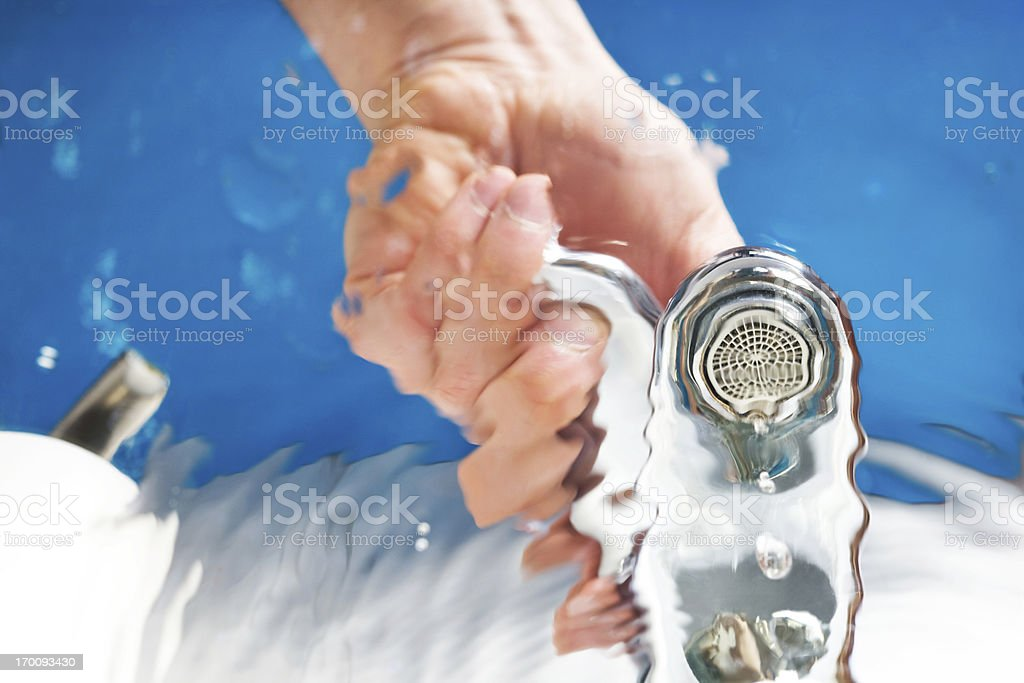 hand opening water tap royalty-free stock photo