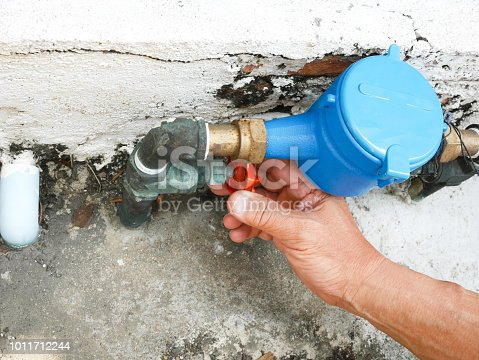 Hand opening water valve by turning handle