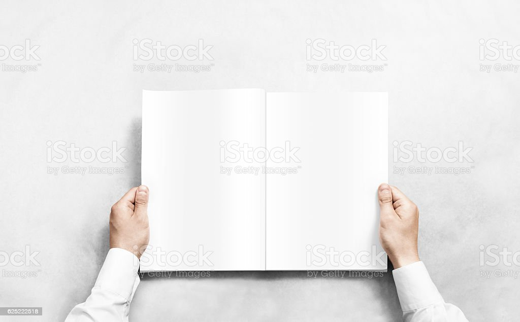 Hand opening white journal with blank pages mockup. stock photo