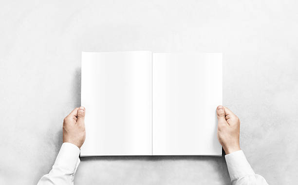 hand opening white journal with blank pages mockup. - livre ouvert photos et images de collection