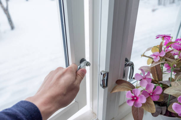 Hand opening window with flower decoration stock photo