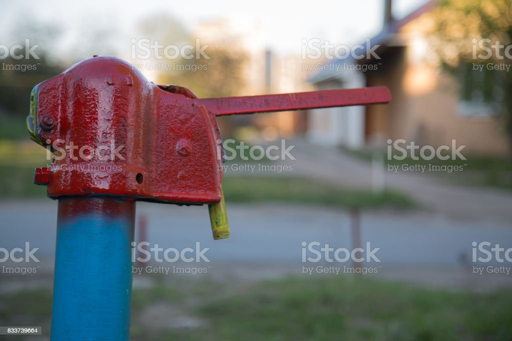 Hand operated street water pump vintage stock photo