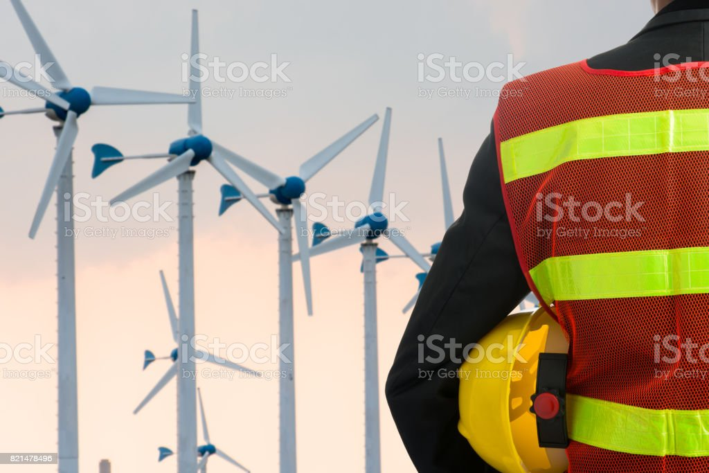 Hand or arm of engineer hold yellow plastic helmet stock photo