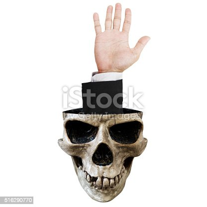 Hand out of skull, isolated on white background
