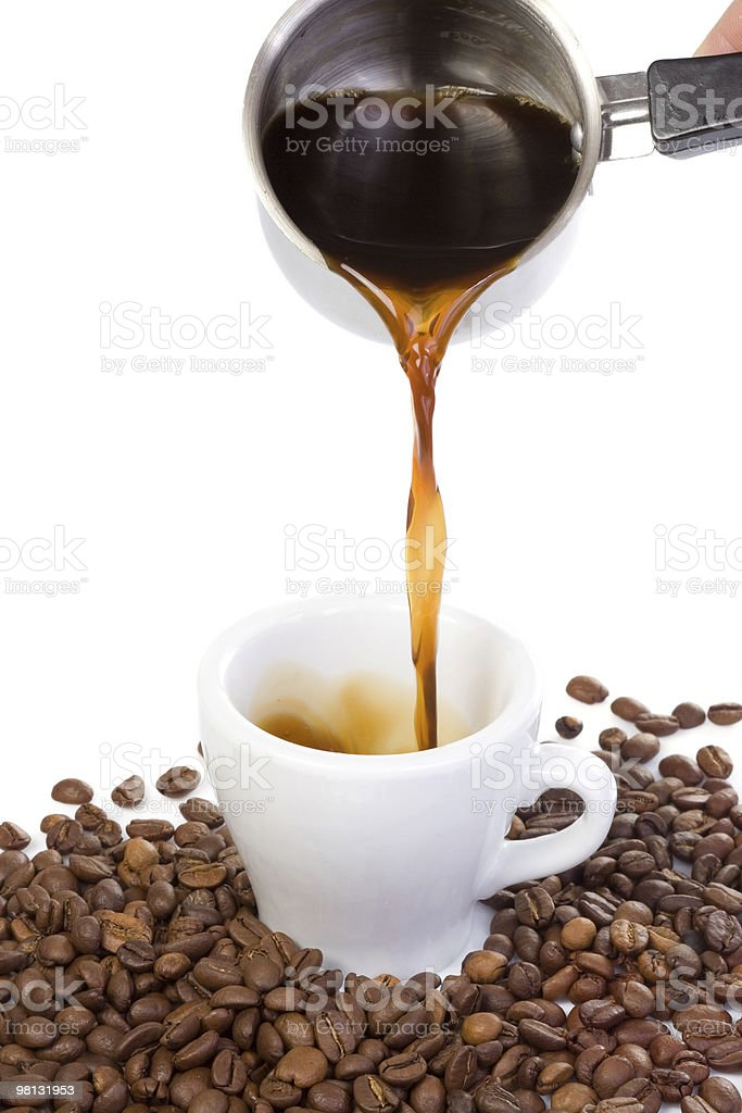 hand outpouring coffee in cup royalty-free stock photo